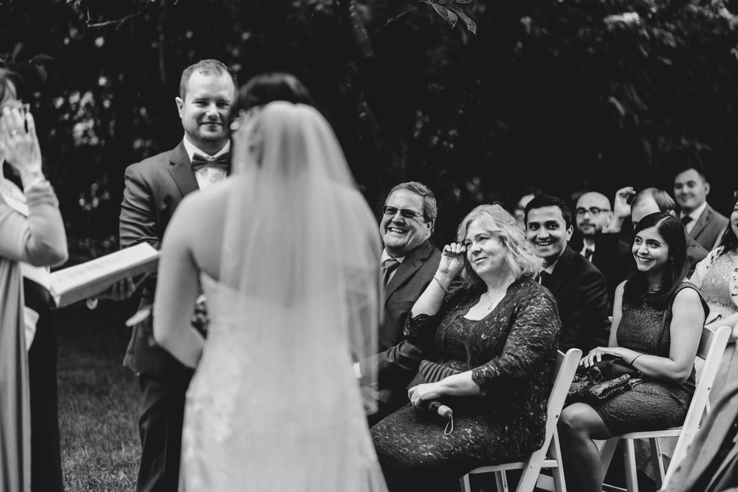 mother of the groom wipes a tear during vows - backyard wedding ottawa