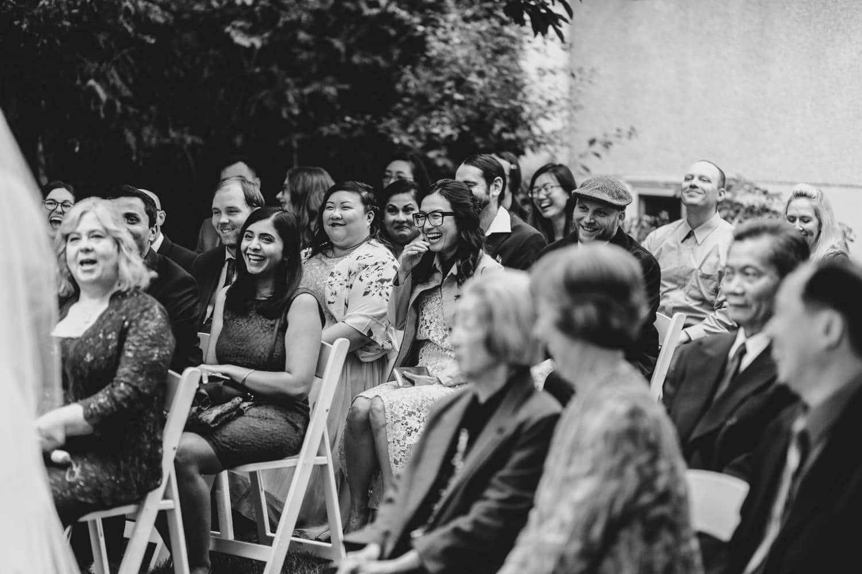 guests laugh during backyard wedding ottawa