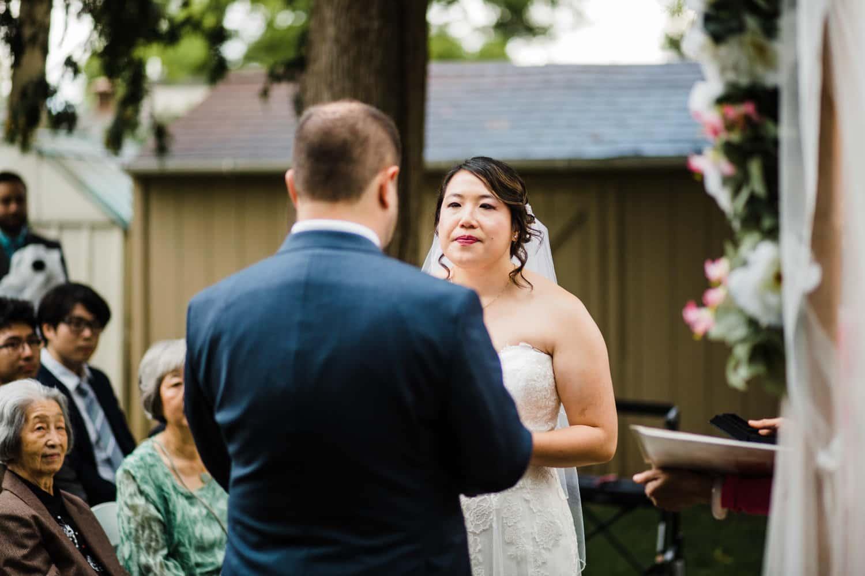 bride cries during backyard wedding ceremony