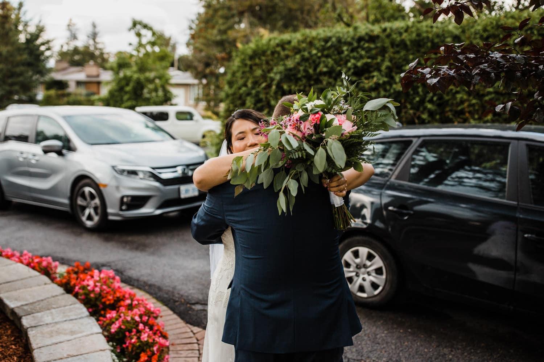 couple hug after ceremony - backyard wedding