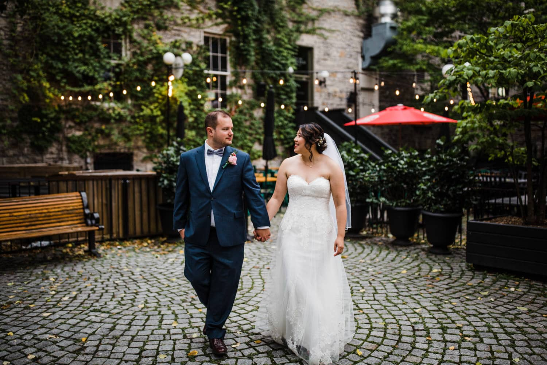 bride and groom walk through byward market - sidedoor wedding reception