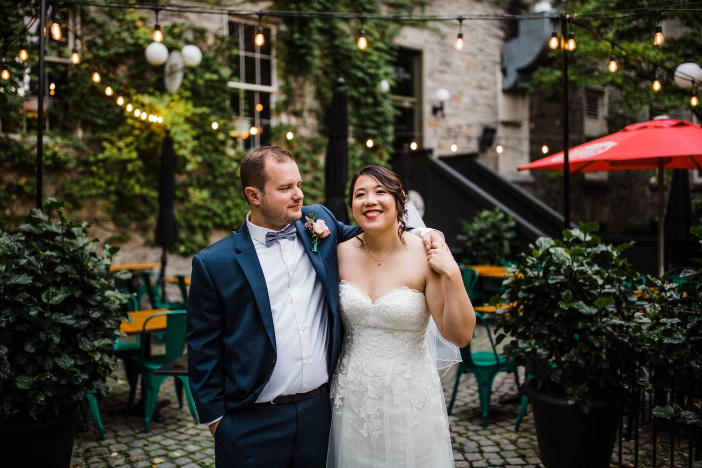 bride and groom in byward market - sidedoor wedding reception