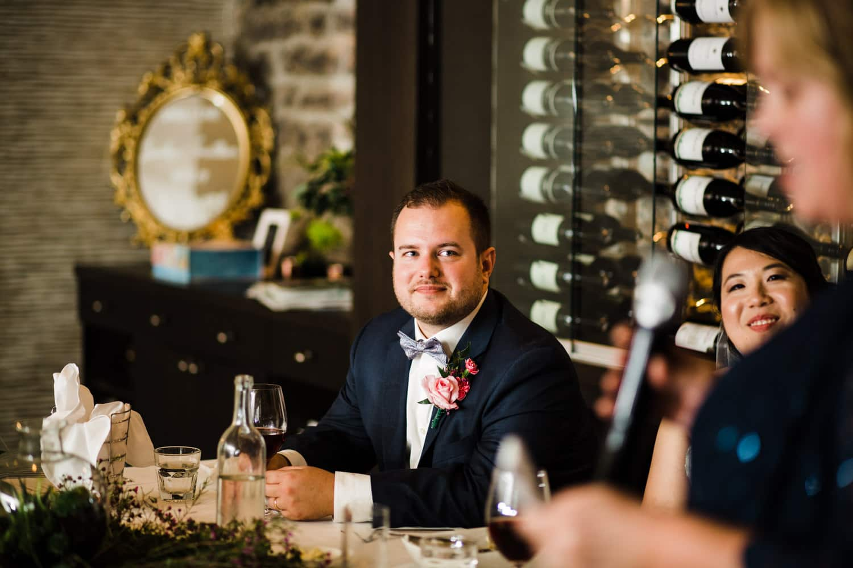 bride and groom listen to speeches - sidedoor wedding reception