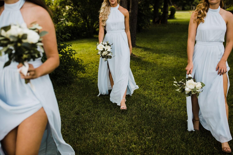 bridesmaids walk in flowy dresses - ottawa wedding photographer