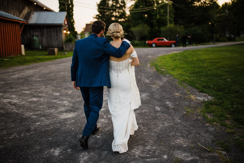 bride and groom walk during sunset - strathmere wedding