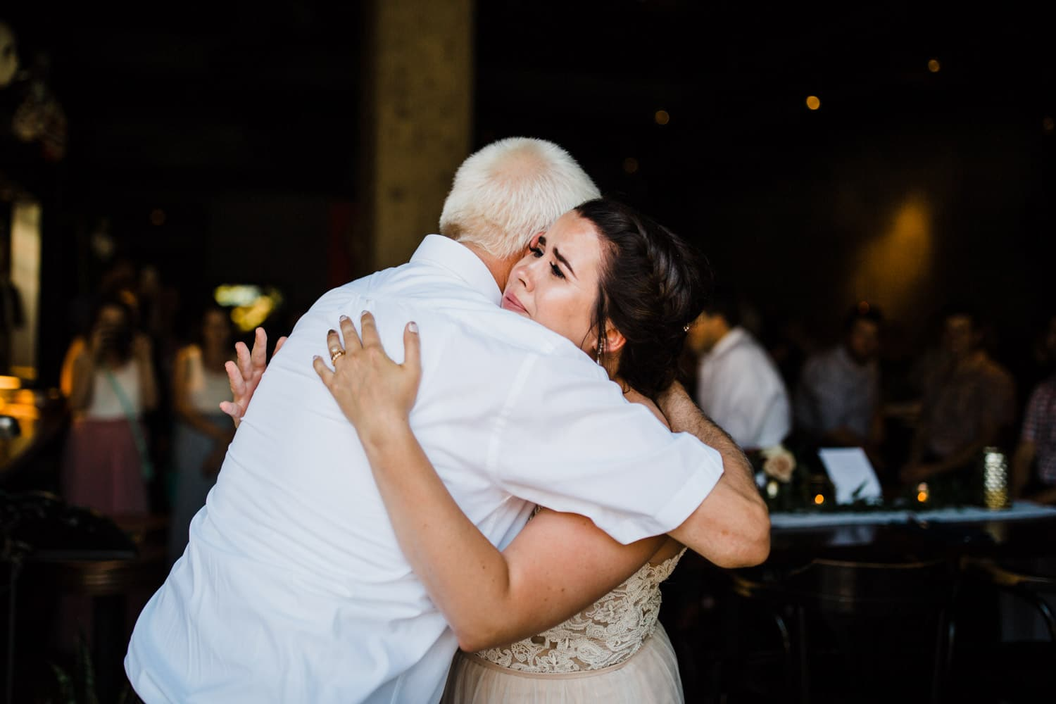 bride cries with her father during father-daughter dance