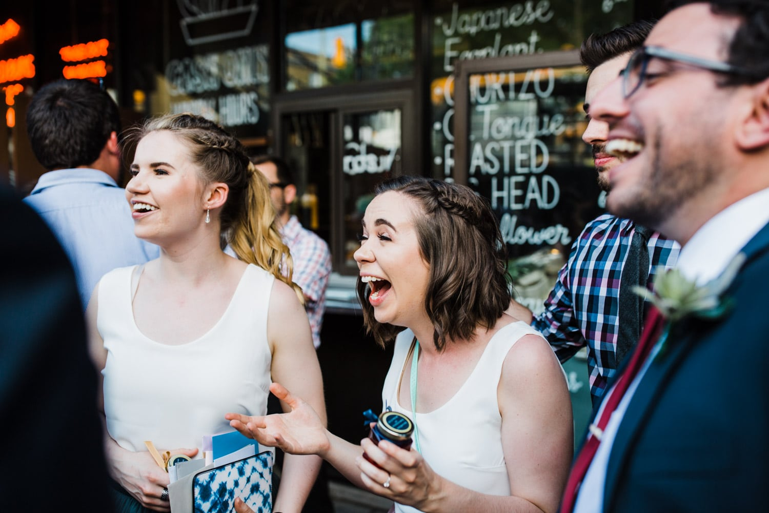 guests laugh together during cocktail hour