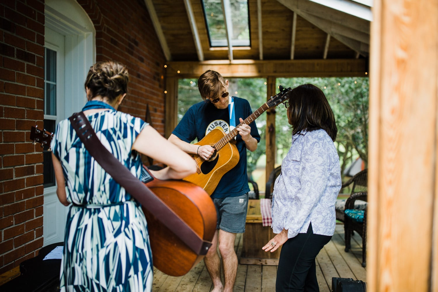 family plays music together morning of the wedding