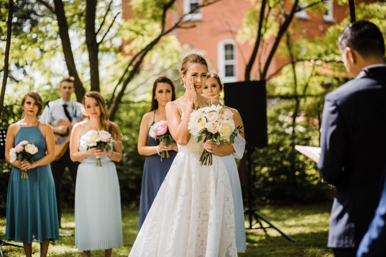 bride cries during wedding ceremony - ottawa wedding photographer
