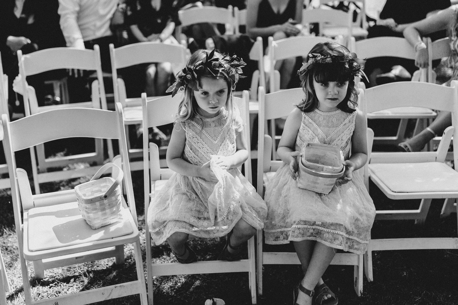 flower girls sit during ceremony