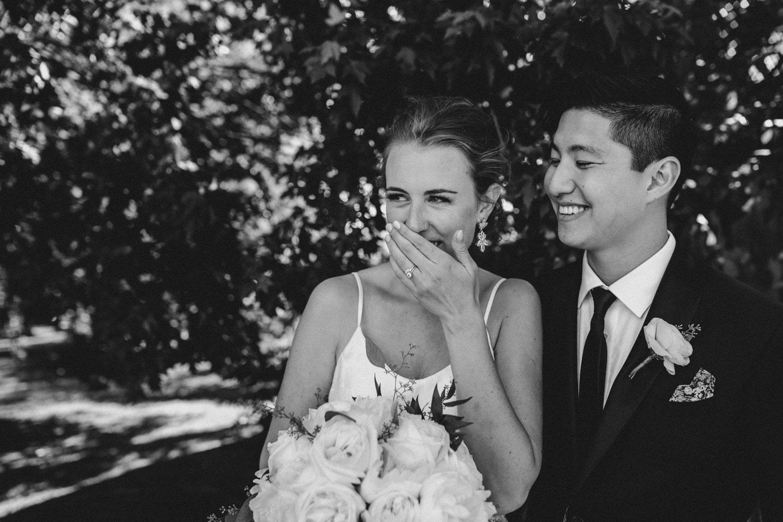 bride and groom giggle together - ottawa backyard wedding