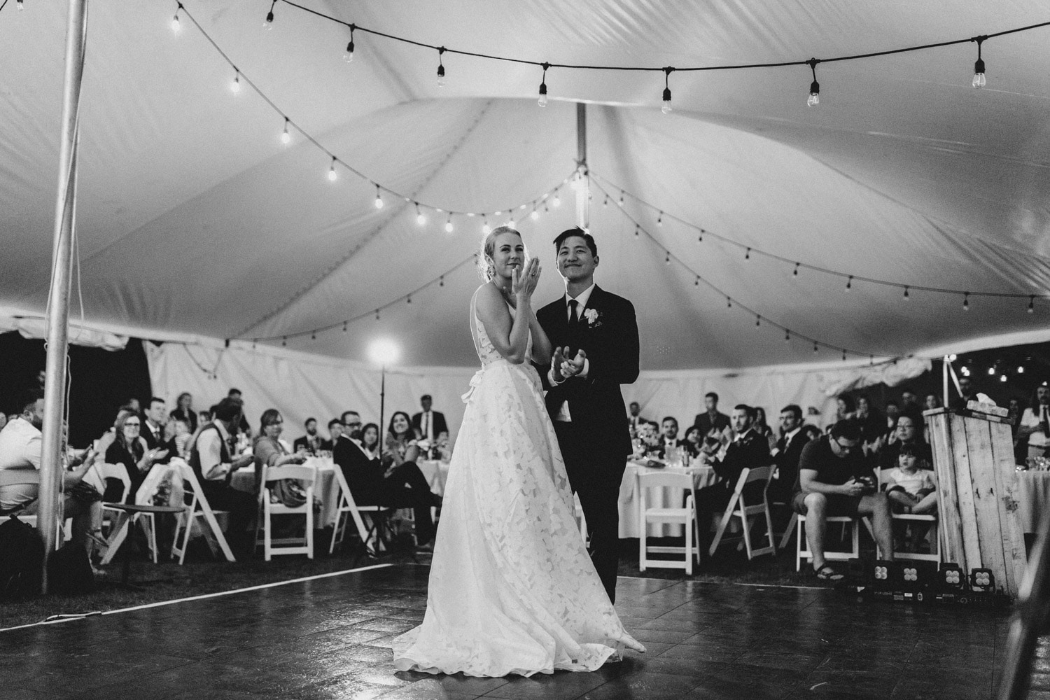 bride and groom dance together under tent - ottawa wedding photographer