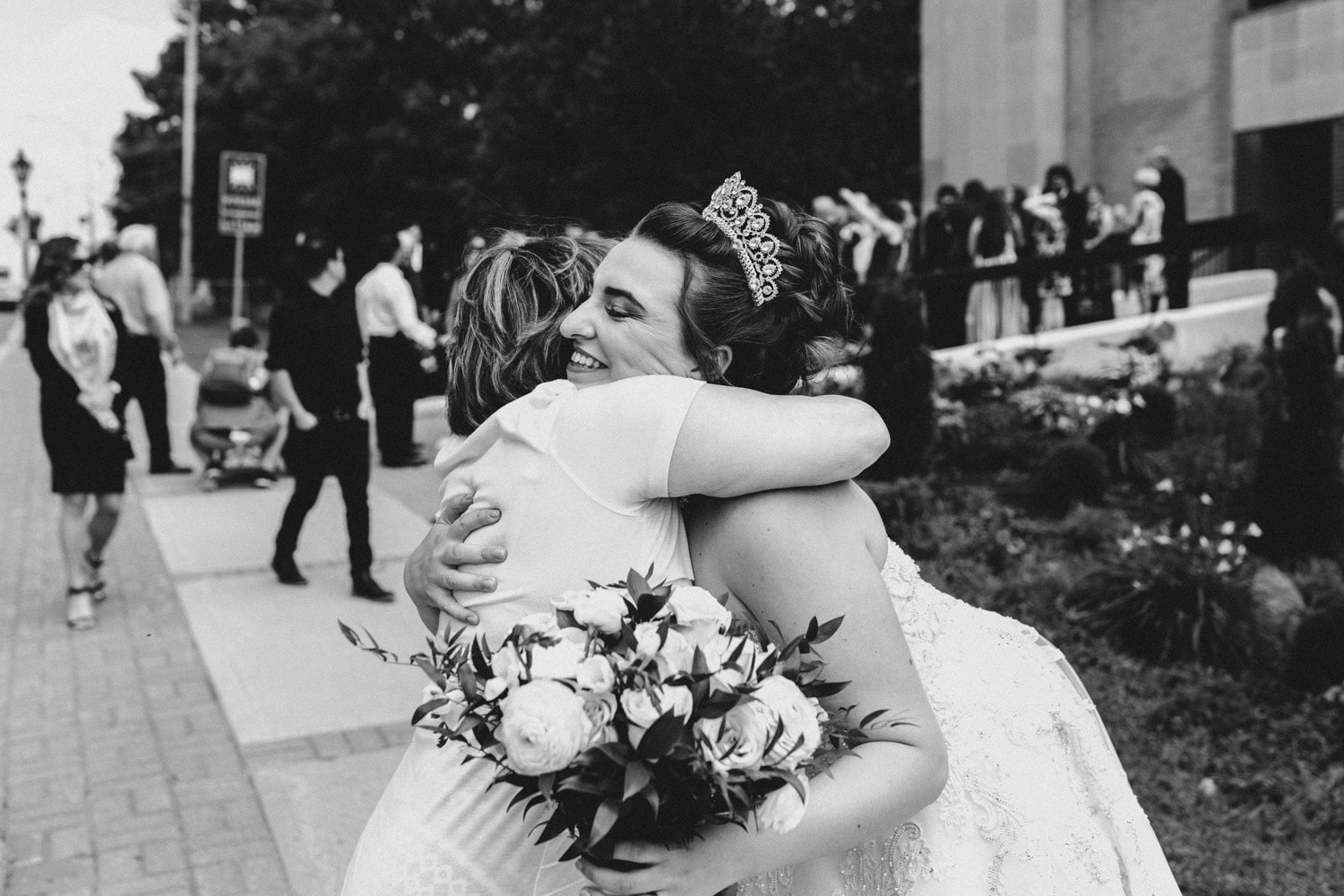 bride hugs guests after wedding - gatineau wedding photographer