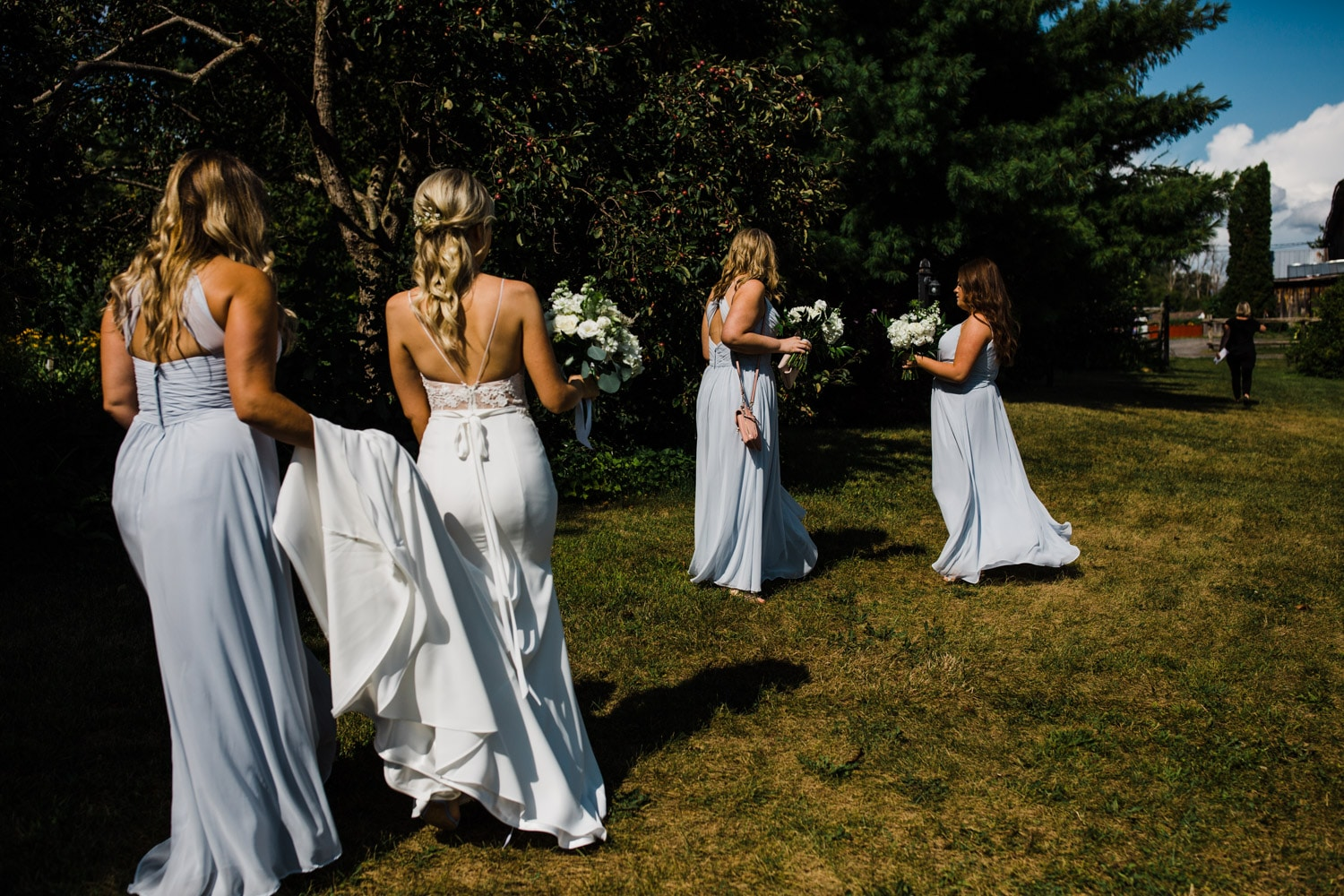 bride walks to ceremony with her bridesmaids - strathmere wedding