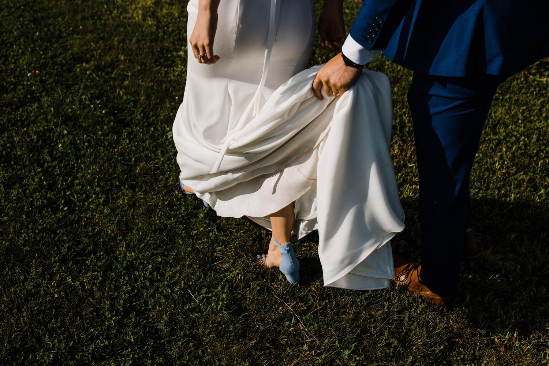 groom carries bride's dress - strathmere wedding