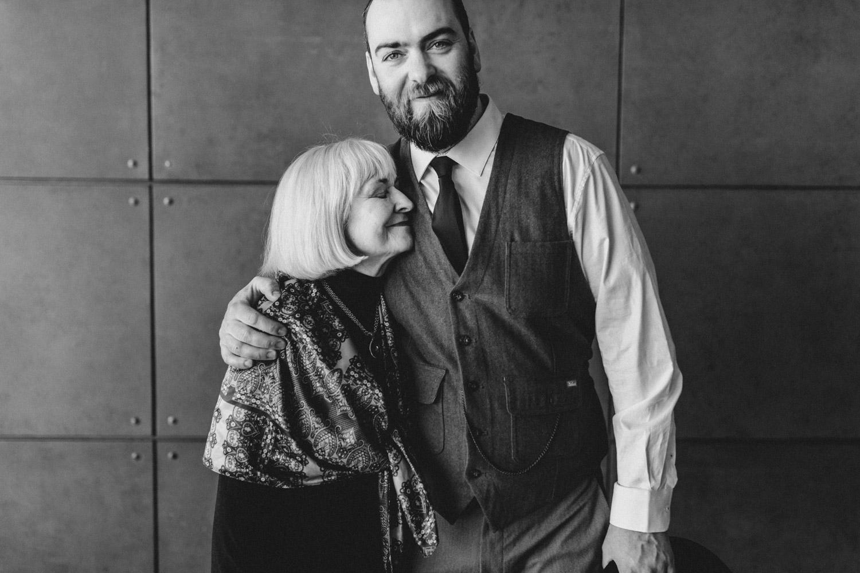 groom embraces his mother on wedding day - ottawa wedding photographer
