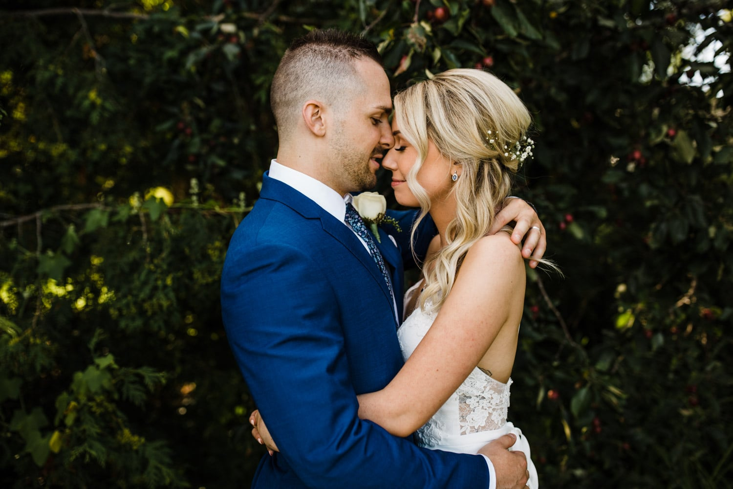 bride and groom hug one another - strathmere wedding