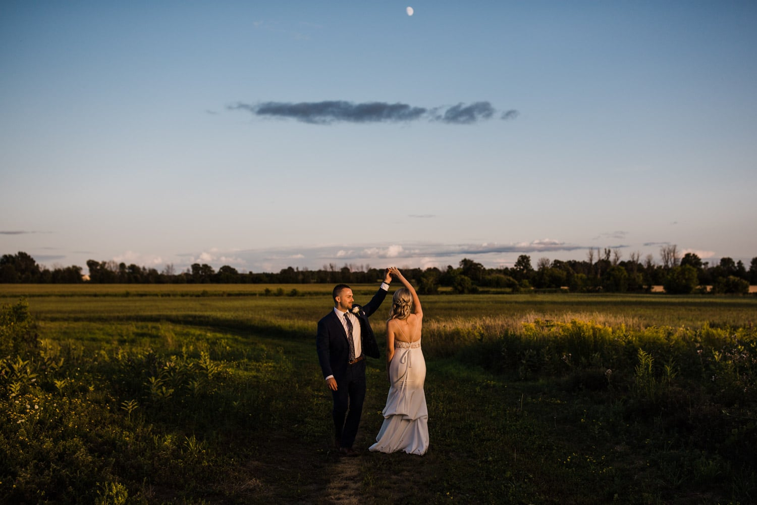 bride and groom dance outside at sunset - strathmere wedding