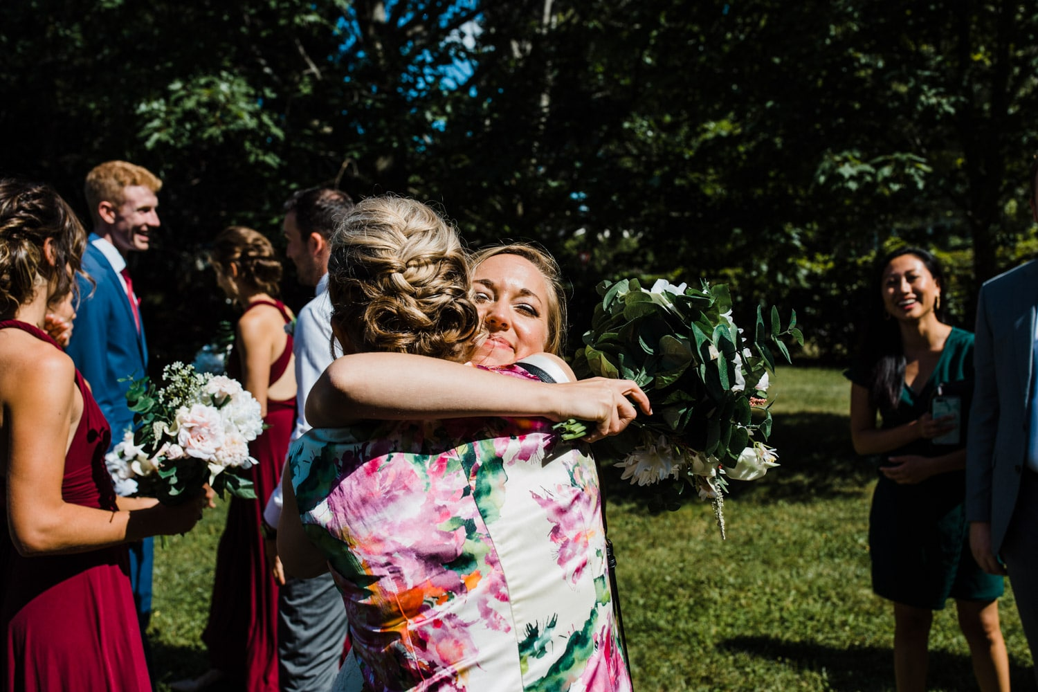 bride hugs mother-in-law after ceremony