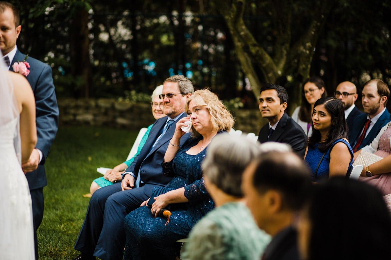 mother of groom cries during ceremony - ottawa backyard wedding