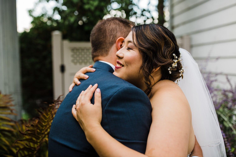 bride and groom hug after backyard wedding ottawa
