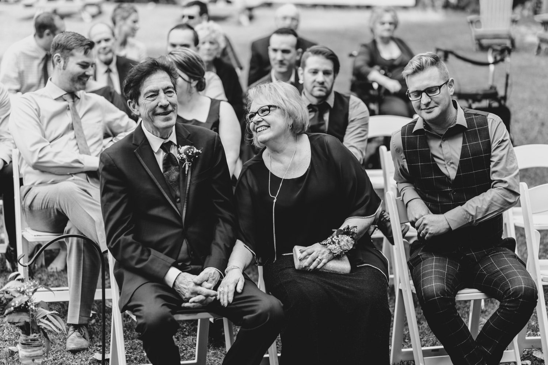 bride's parents laugh during ceremony