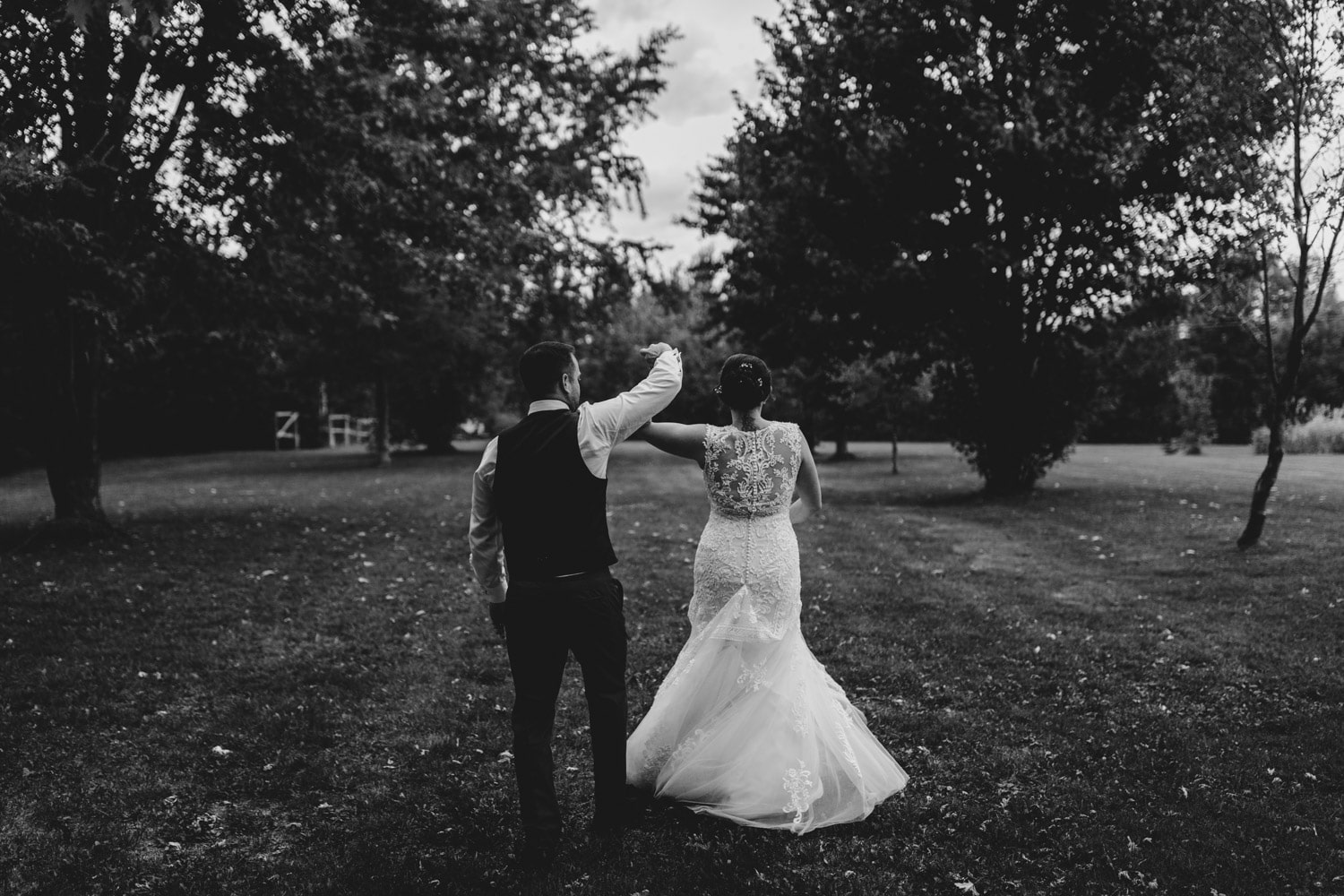 bride and groom dance together outside
