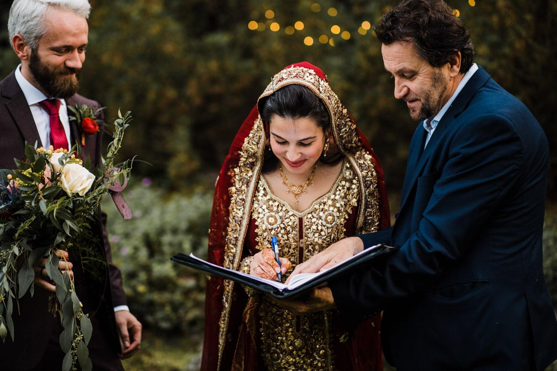 bride signs wedding registry - ottawa wedding photographer