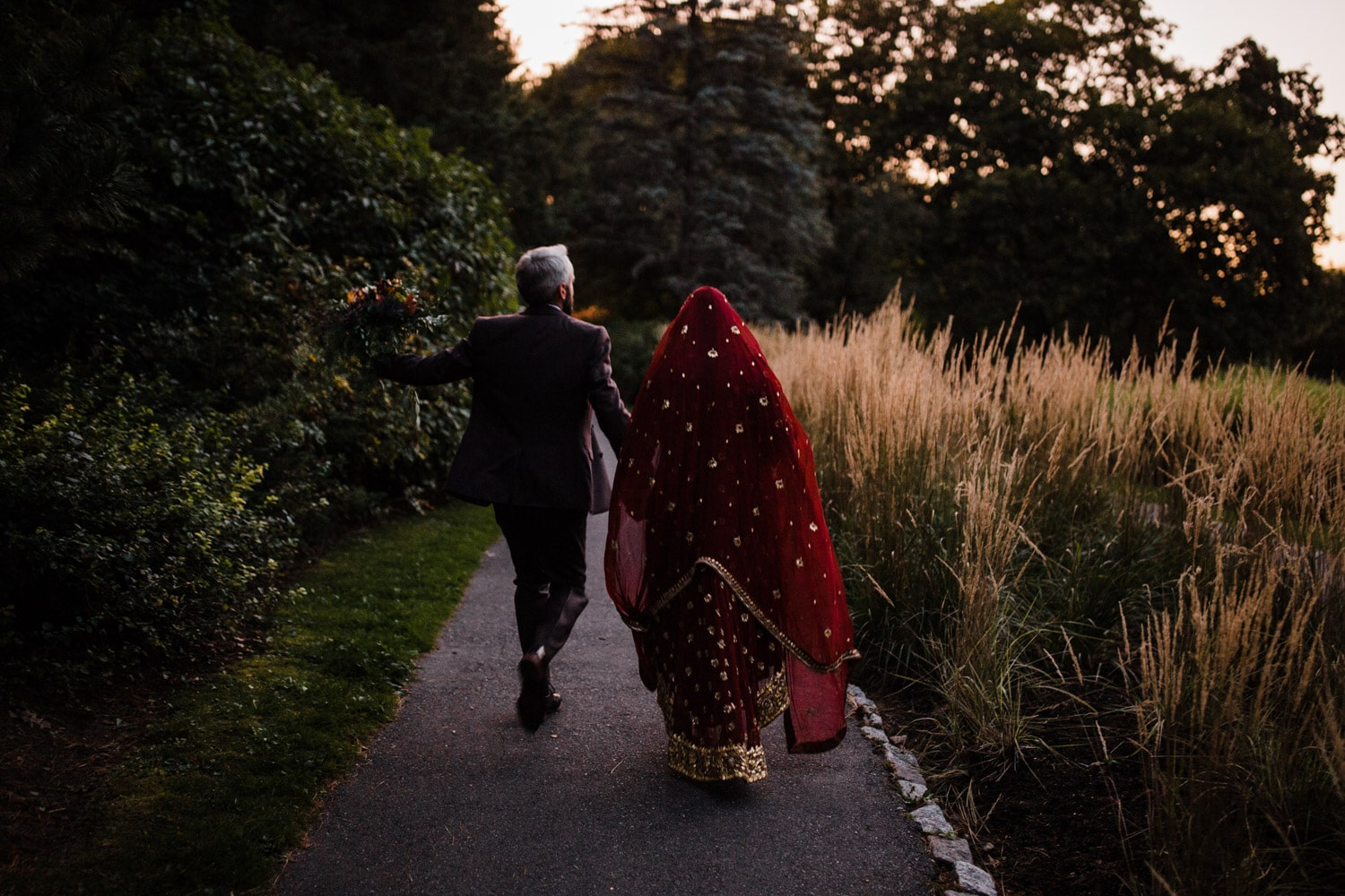 bride and groom walk together during sunset - ottawa wedding photographer