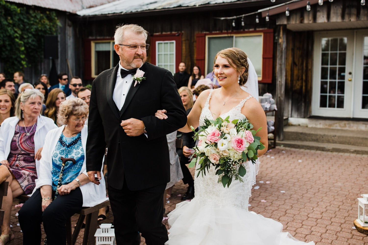 bride walks down the aisle with her father - strathmere wedding