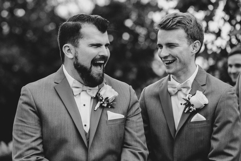 groomsmen laugh during ceremony - ottawa wedding photographer