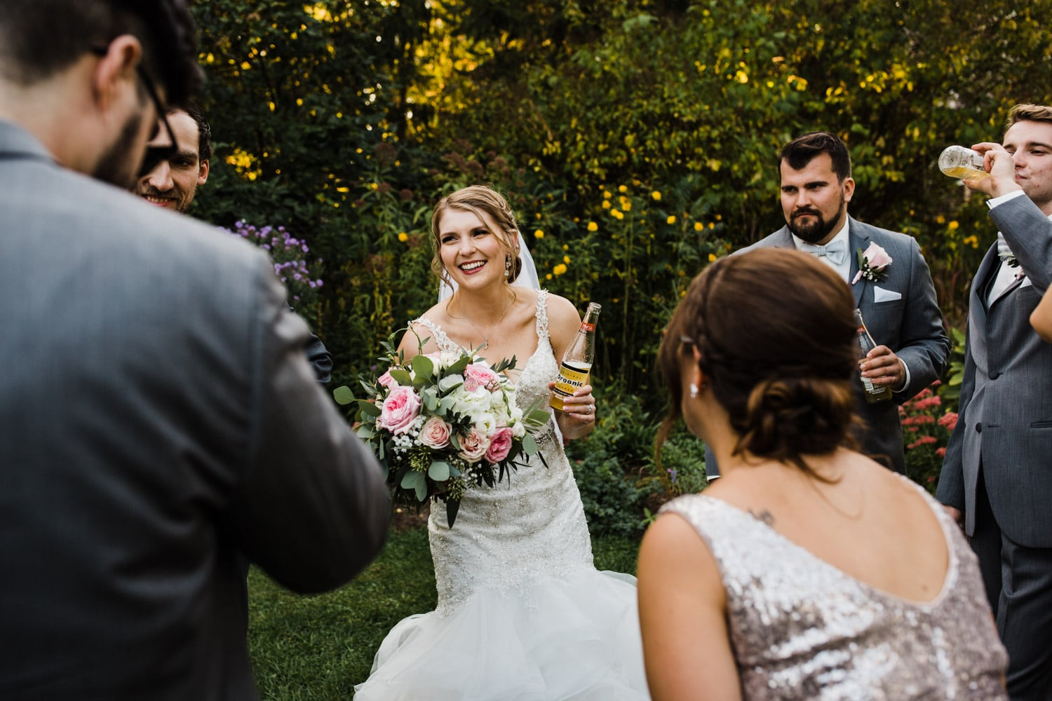 bride laughs with wedding party - strathmere wedding