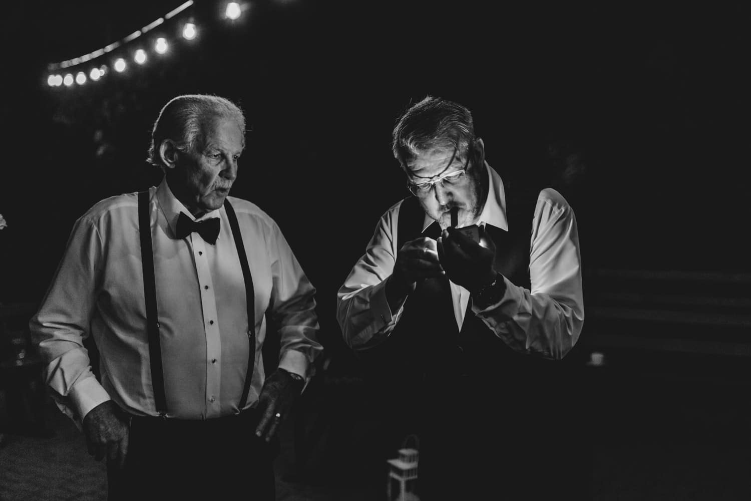 father of the bride lights up a cigar