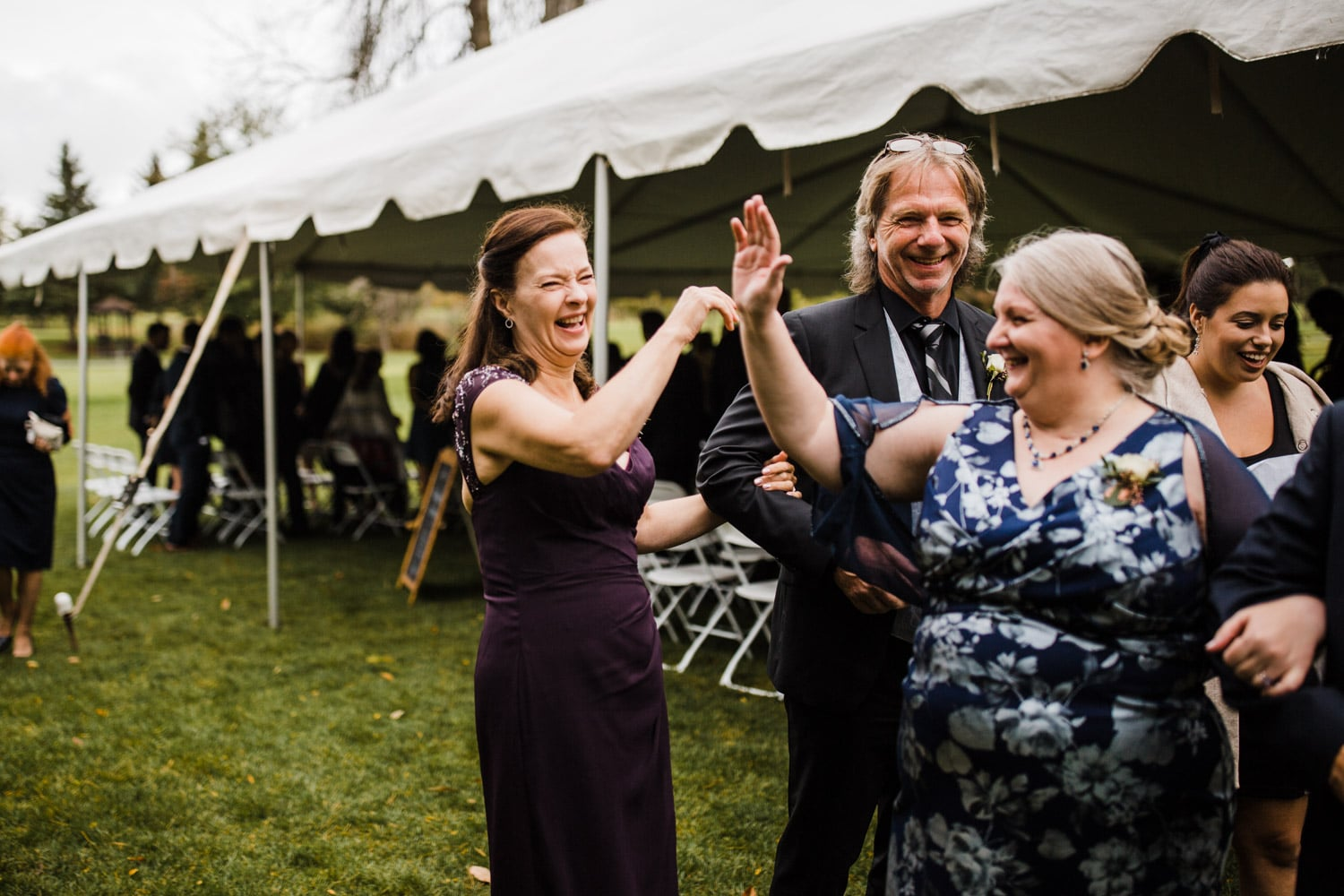 mothers of bride and groom celebrate with high-five after ceremony