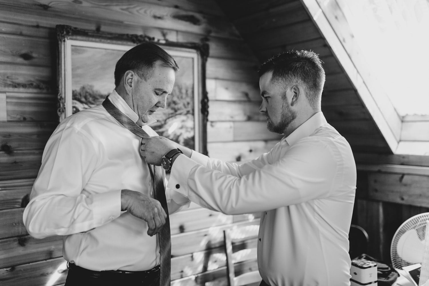 groom helps dad with his tie