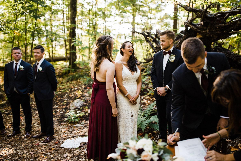 bride laughs during ceremony - ottawa wedding photographer