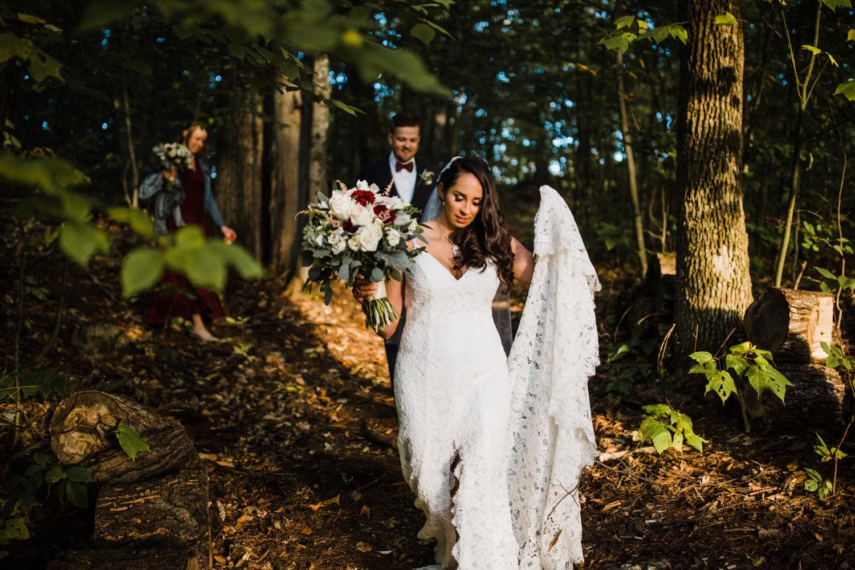 bride walks through forest together
