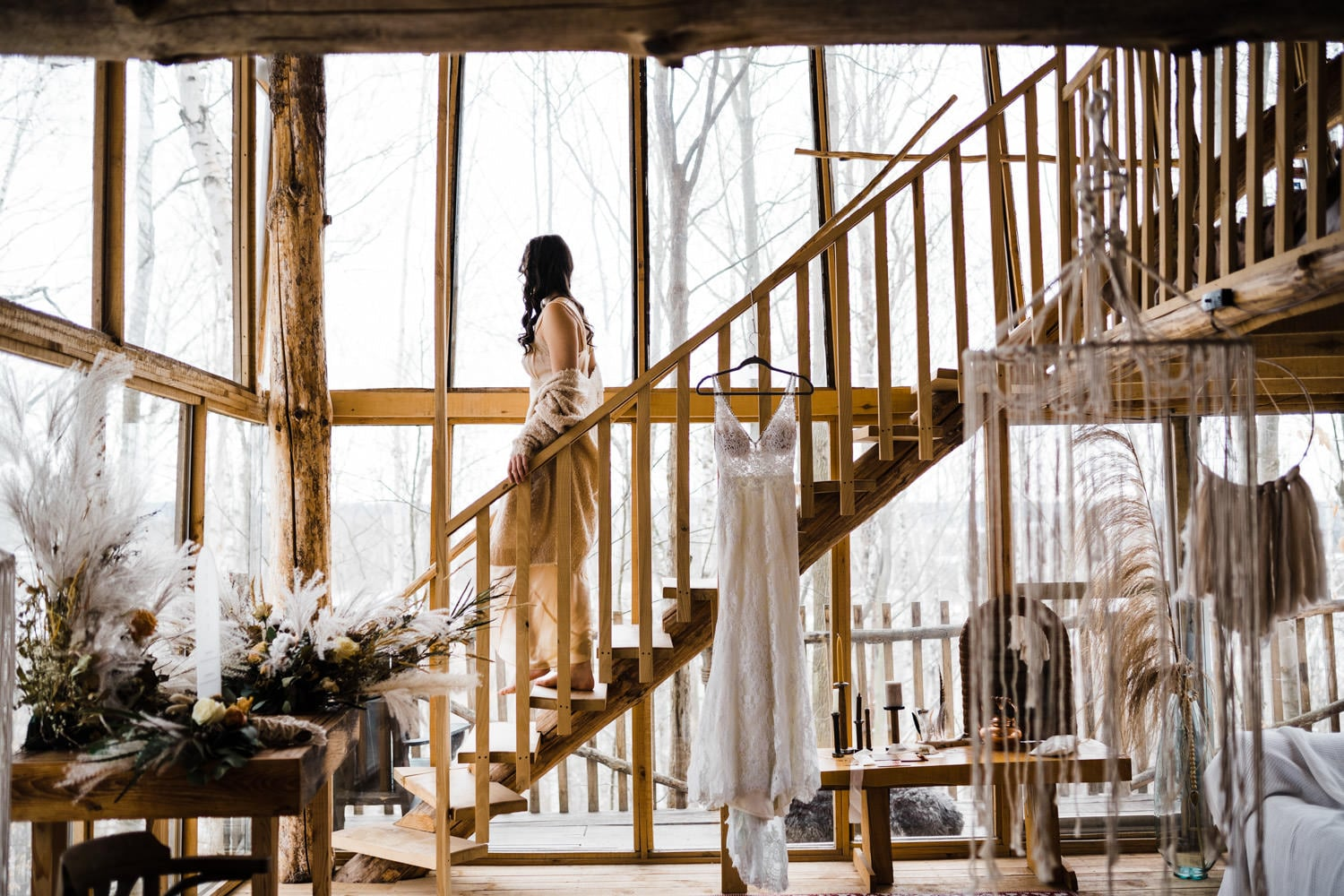 bride walks down stairs in cabin in the woods - boho elopement