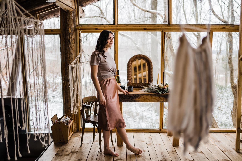 bride admires details in cozy cabin