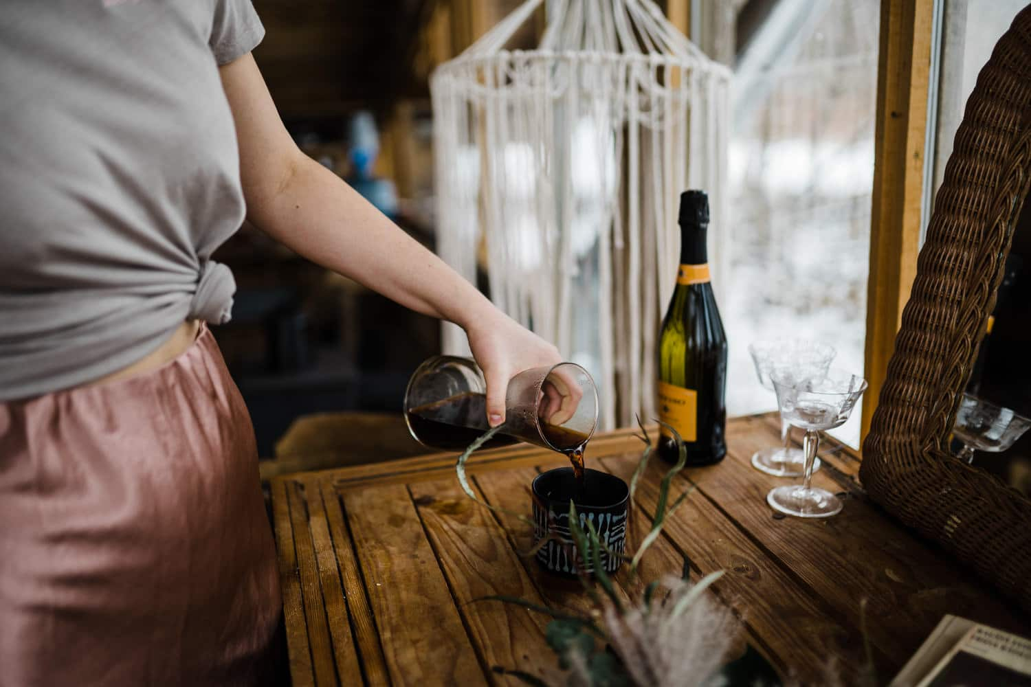 bride pours her morning coffee - winter elopement