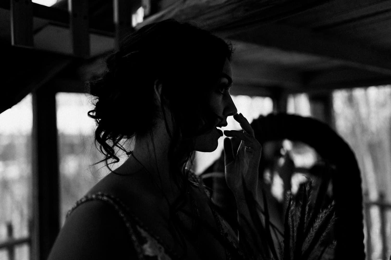 bride touches her lip - winter elopement