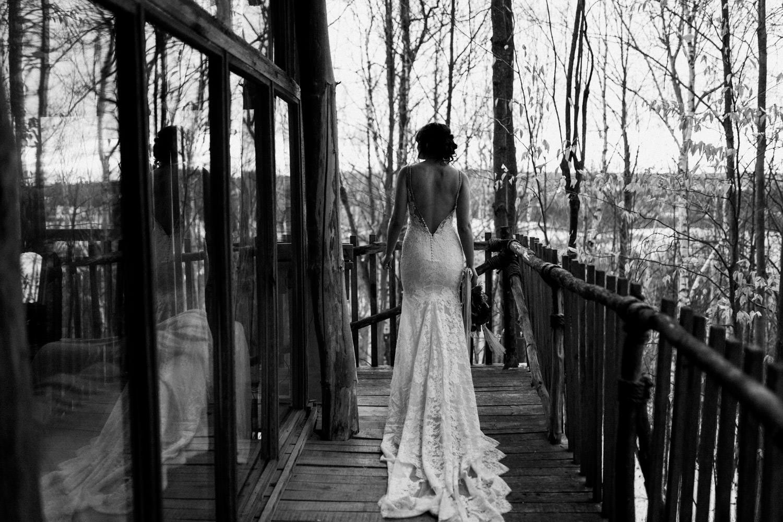 bride walks along cabin for winter elopement