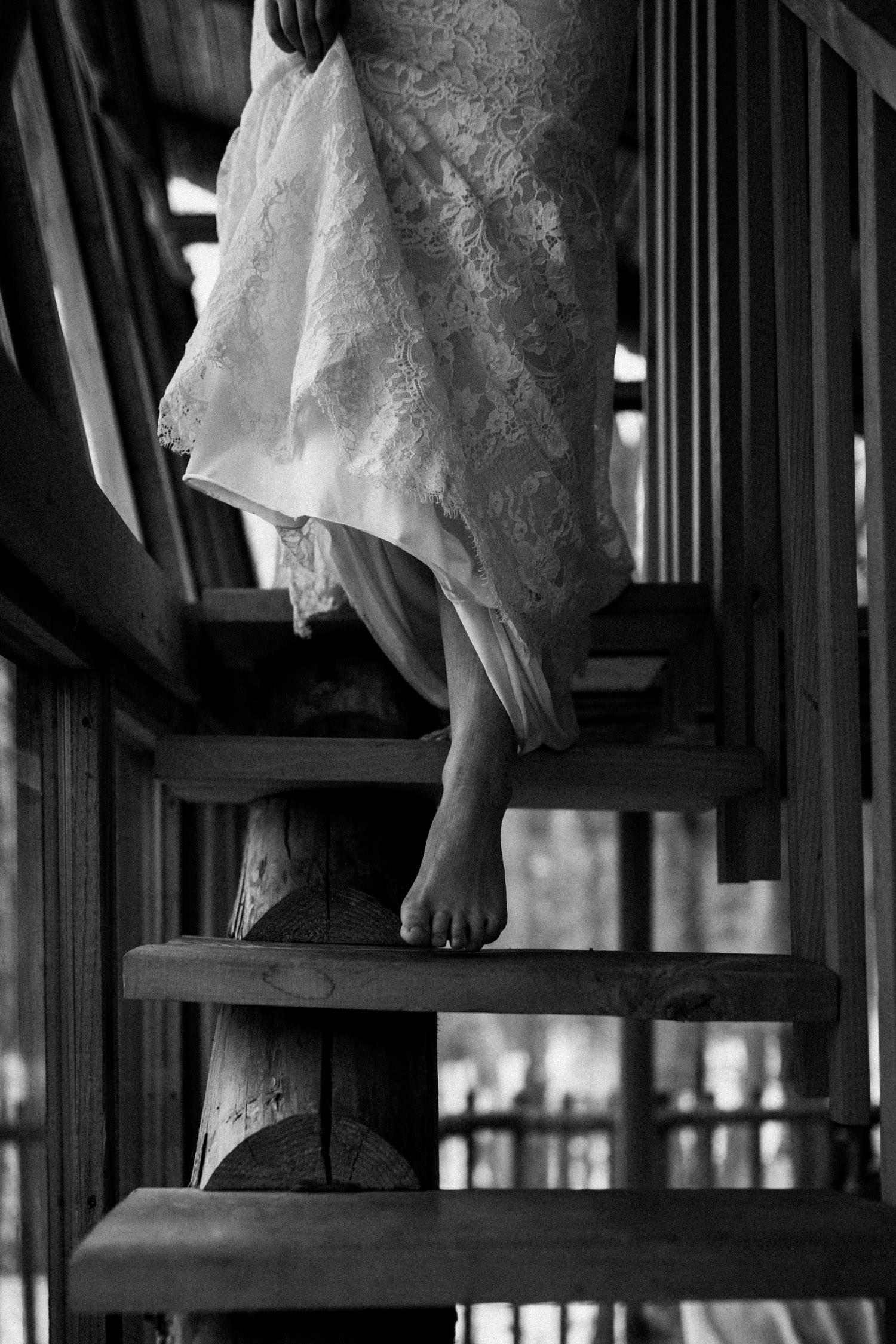 bride walks down stairs - winter boho elopement