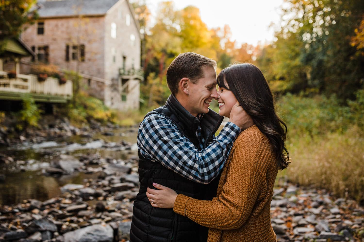 couple laugh together - mill of kintail engagement - fall engagement