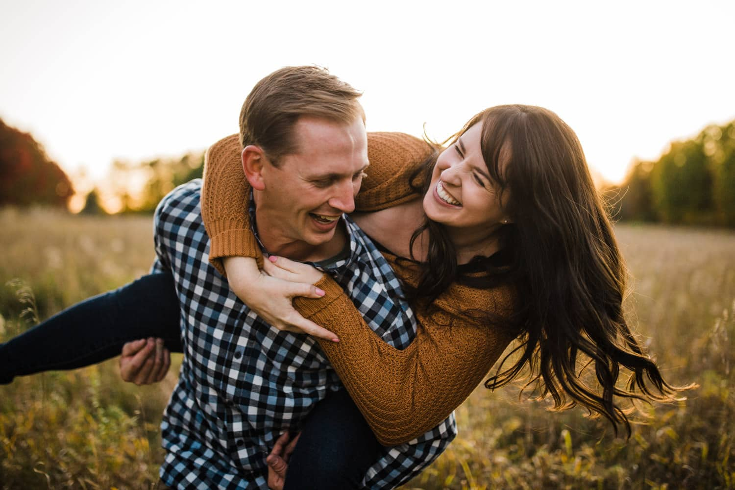 couple laughs playfully together - ottawa fall engagement