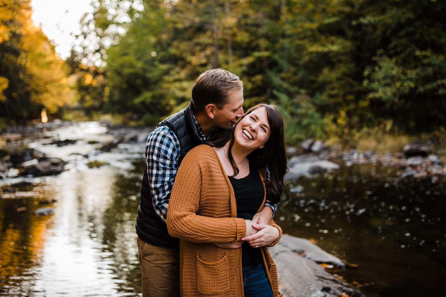 man whispers something funny in woman's ear - mill of kintail engagement