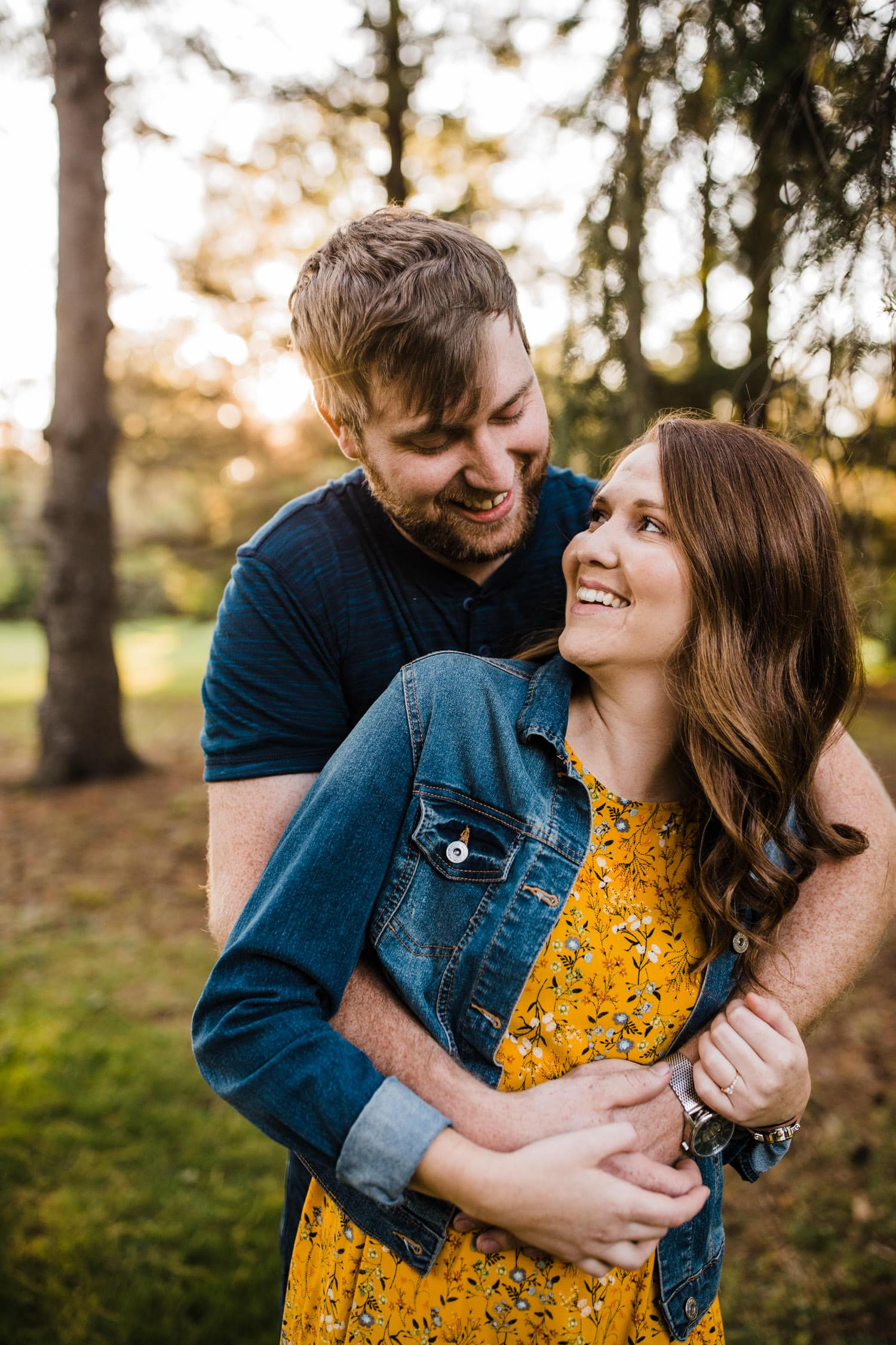 couple laugh and look at one another - ottawa arboretum engagement