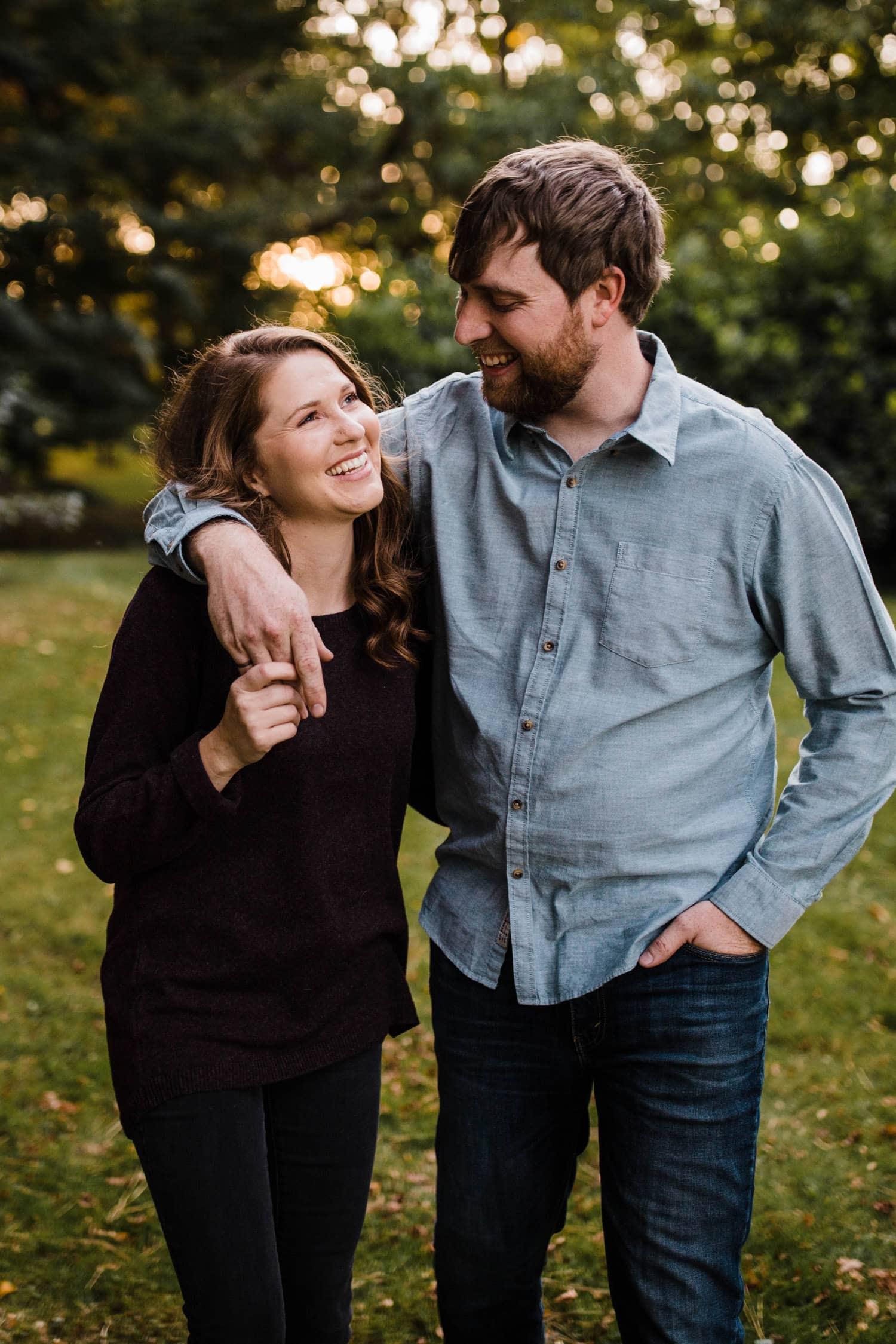 couple laugh and walk together - ottawa arboretum engagement