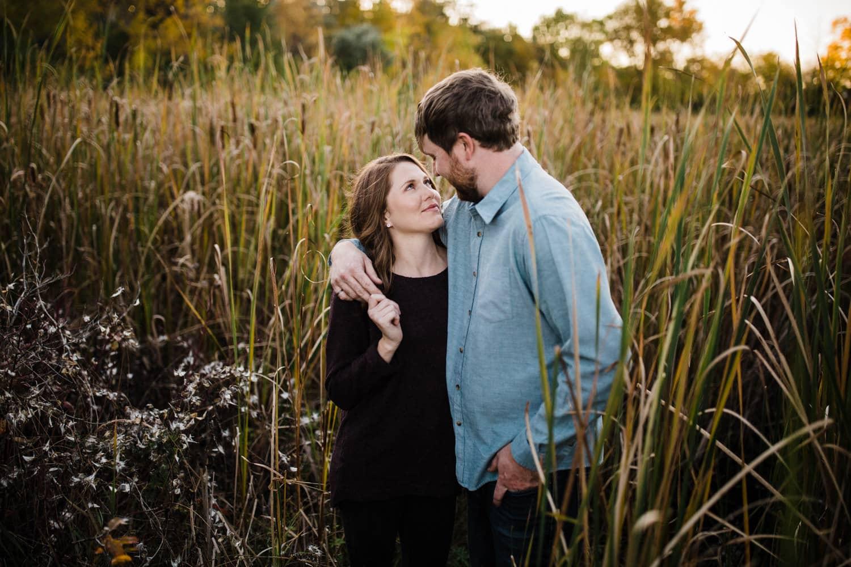 couple stand amongst tall grass - ottawa fall engagement