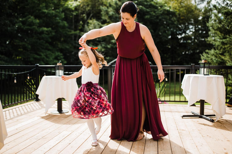 flower girl twirls in her dress - station 4 saisons wedding